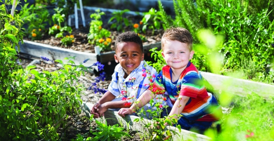 boys take part in compost messy play