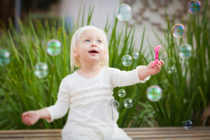 Adorable Little Girl Having Fun With Bubbles